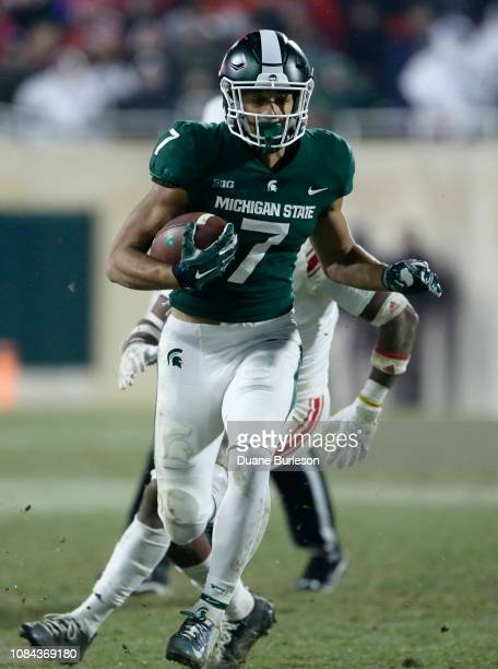 Wide receiver Cody White of the Michigan State Spartans carries the ball against the Rutgers Scarlet Knights during the second half at Spartan...