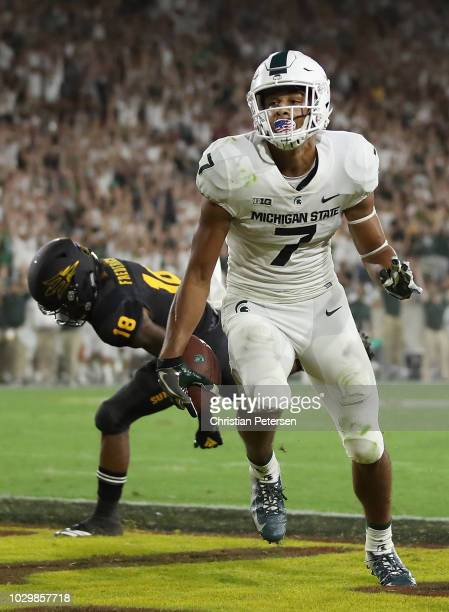 Wide receiver Cody White of the Michigan State Spartans catches a 31 yard touchdown reception past cornerback Langston Frederick of the Arizona State...