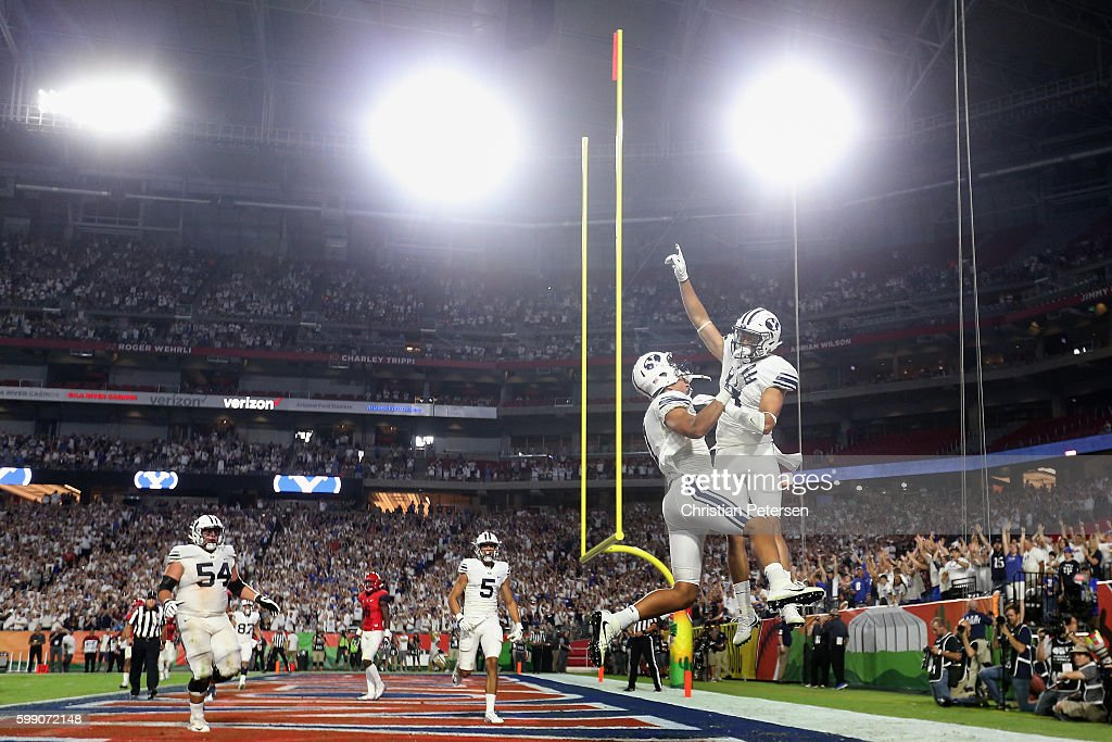 Wide receiver Colby Pearson #3 of the Brigham Young Cougars celebrates with Moroni Laulu-Pututau #1 after Pearson scored a six yard touchdown reception against the Arizona Wildcats during the second half of the college football game at University of Phoenix Stadium on September 3, 2016 in Glendale, Arizona. The Cougars defeated the Wildcats 18-16.