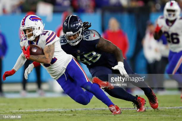 Wide receiver Cole Beasley of the Buffalo Bills is tackled by outside linebacker Bud Dupree of the Tennessee Titans during the second half at Nissan...