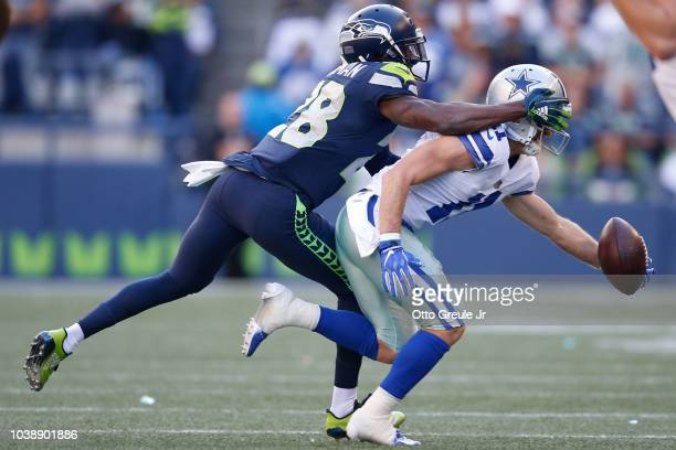 Wide Receiver Cole Beasley of the Dallas Cowboys catches the ball as Cornerback Justin Coleman of the Seattle Seahawks attempts to make a tackle...