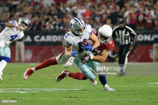 Wide receiver Cole Beasley of the Dallas Cowboys is hit by strong safety Tyvon Branch of the Arizona Cardinals during the second half of the NFL game...