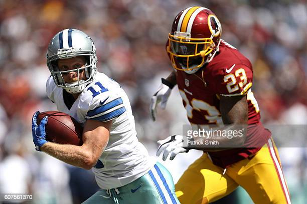 Wide receiver Cole Beasley of the Dallas Cowboys is tackled by free safety DeAngelo Hall of the Washington Redskins in the first quarter at...