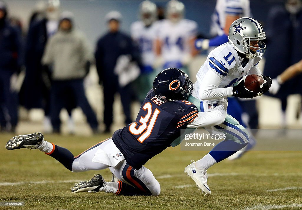 Wide receiver Cole Beasley #11 of the Dallas Cowboys is tackled by cornerback Isaiah Frey #31 of the Chicago Bears during a game at Soldier Field on December 9, 2013 in Chicago, Illinois.