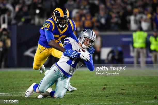 Wide receiver Cole Beasley of the Dallas Cowboys makes a catch for a first down in the fourth quarter in front of linebacker Micah Kiser of the Los...