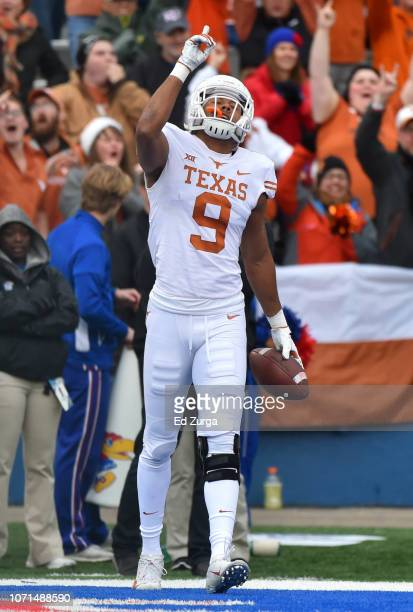 Wide receiver Collin Johnson of the Texas Longhorns celebrates his touchdown reception against the Kansas Jayhawks in first quarter at Memorial...