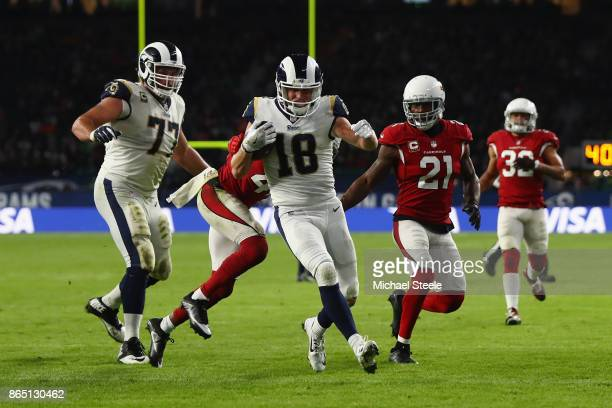 Wide Receiver Cooper Kupp of Los Angeles Rams scores a touchdown during the NFL game between Arizona Cardinals and Los Angeles Rams at Twickenham...
