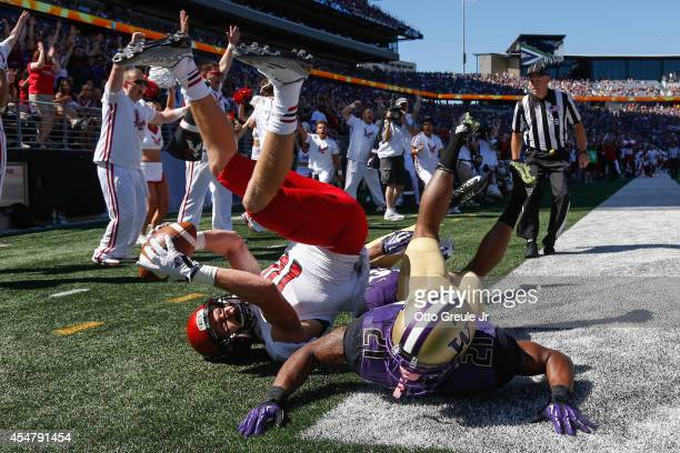 Wide receiver Cooper Kupp of the Eastern Washington Eagles scores a touchdown against defensive back Kevin King of the Washington Huskies on...