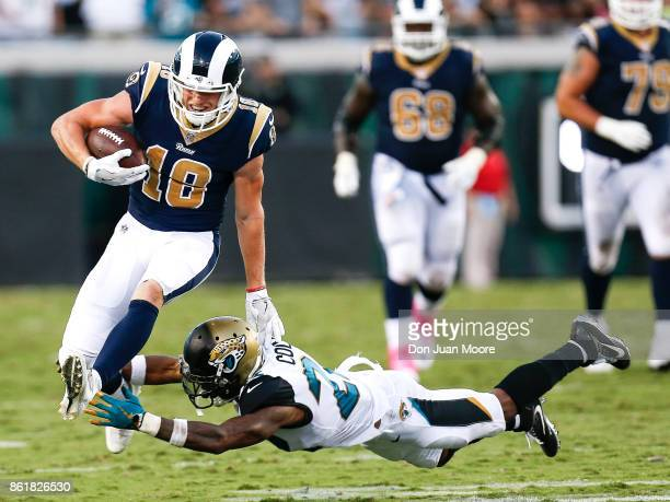Wide Receiver Cooper Kupp of the Los Angeles Rams avoids a tackle by Cornerback Aaron Colvin of the Jacksonville Jaguars during the game at EverBank...