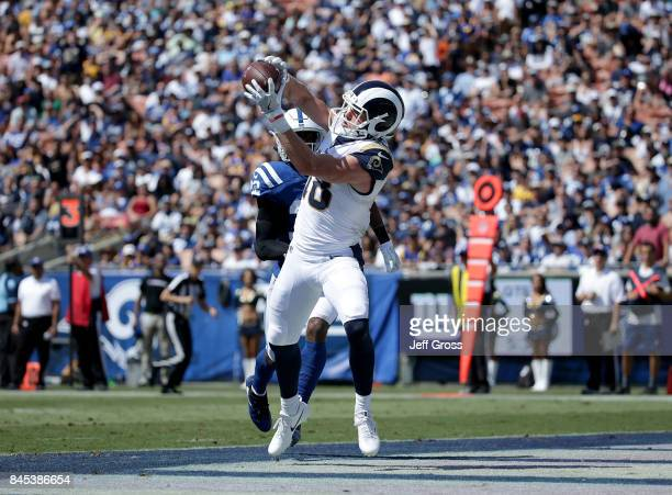 Wide receiver Cooper Kupp of the Los Angeles Rams catches a pass for a touchdown in front of free safety TJ Green of the Indianapolis Colts in the...
