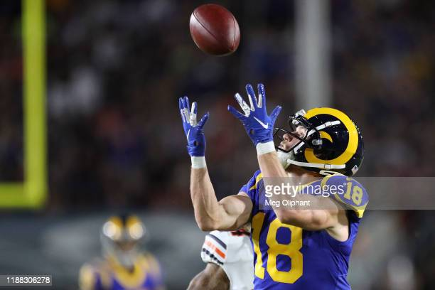 Wide receiver Cooper Kupp of the Los Angeles Rams catches a pass from quarterback Jared Goff for a touchdown that was reversed during the first half...