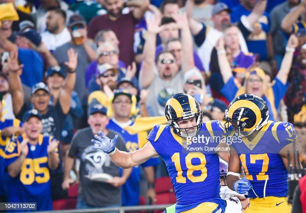 Wide receiver Cooper Kupp of the Los Angeles Rams celebrates his touchdown with wide receiver Robert Woods at Los Angeles Memorial Coliseum on...