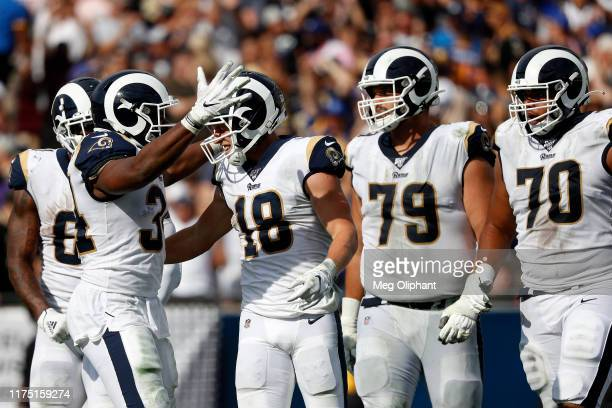 Wide receiver Cooper Kupp of the Los Angeles Rams celebrates his run in the fourth quarter against the New Orleans Saints at Los Angeles Memorial...
