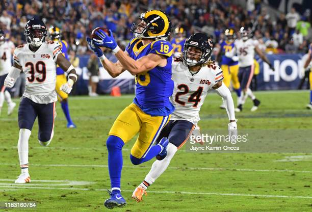 Wide receiver Cooper Kupp of the Los Angeles Rams hangs on to a complete pass before he is stopped by cornerback Buster Skrine of the Chicago Bears...