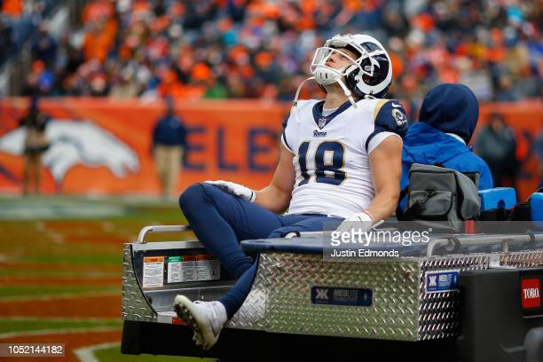 wide receiver Cooper Kupp of the Los Angeles Rams is carted off the field with a knee injury during the second quarter against the Denver Broncos at...