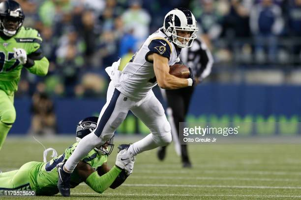 Wide receiver Cooper Kupp of the Los Angeles Rams is tackled by free safety Tedric Thompson of the Seattle Seahawks at CenturyLink Field on October 3...