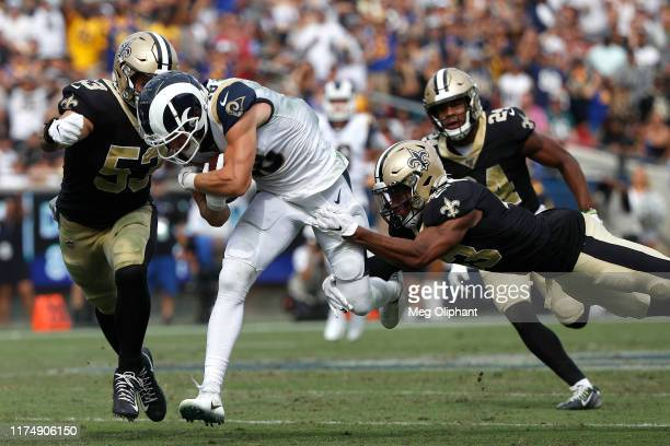 Wide receiver Cooper Kupp of the Los Angeles Rams is tackled by free safety Marcus Williams of the New Orleans Saints at Los Angeles Memorial...