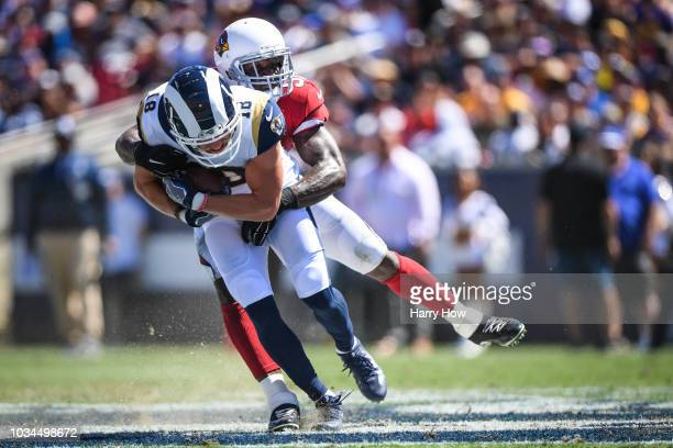 Wide receiver Cooper Kupp of the Los Angeles Rams is tackled by linebacker Gerald Hodges of the Arizona Cardinals after his catch in the first...