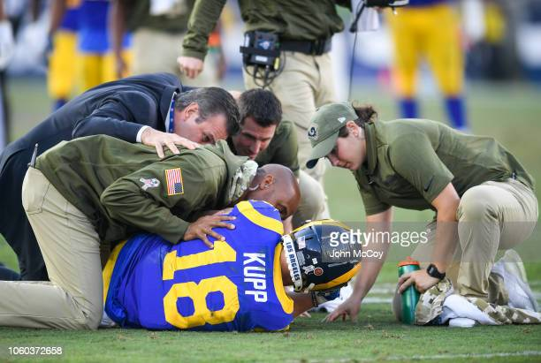 Wide receiver Cooper Kupp of the Los Angeles Rams is tended to after being injured in the game against the Seattle Seahawks at Los Angeles Memorial...