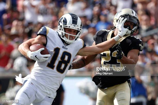 Wide receiver Cooper Kupp of the Los Angeles Rams runs defended by cornerback Marshon Lattimore of the New Orleans Saints at Los Angeles Memorial...