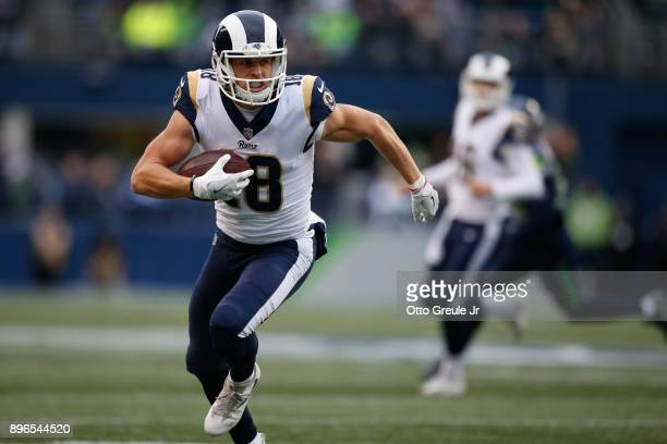 Wide receiver Cooper Kupp of the Los Angeles Rams rushes against the Seattle Seahawks at CenturyLink Field on December 17 2017 in Seattle Washington
