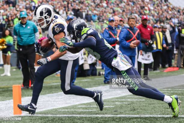 Wide Receiver Cooper Kupp of the Los Angeles Rams scores a touchdown in the first half against the Seattle Seahawks at CenturyLink Field on October 7...