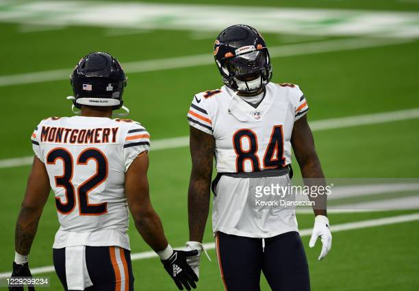 Wide receiver Cordarrelle Patterson and running back David Montgomery of the Chicago Bears warm up before the start of the game against Los Angeles...