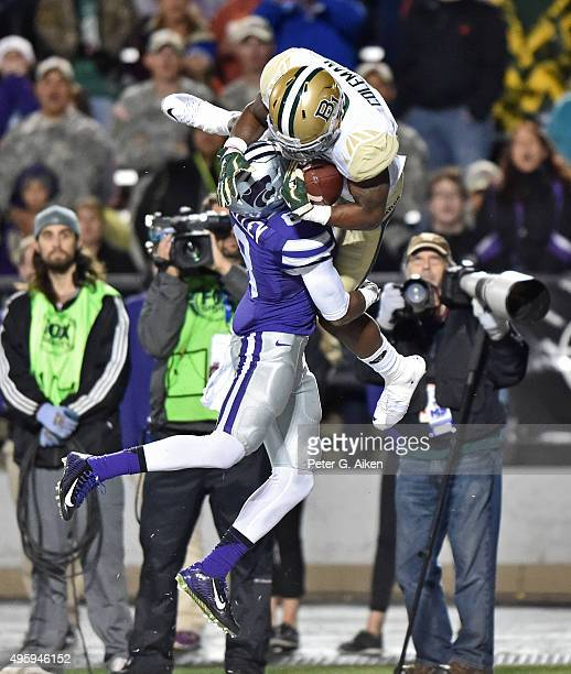 Wide receiver Corey Coleman of the Baylor Bears catches a touchdown pass over defensive back Duke Shelley of the Kansas State Wildcats during the...