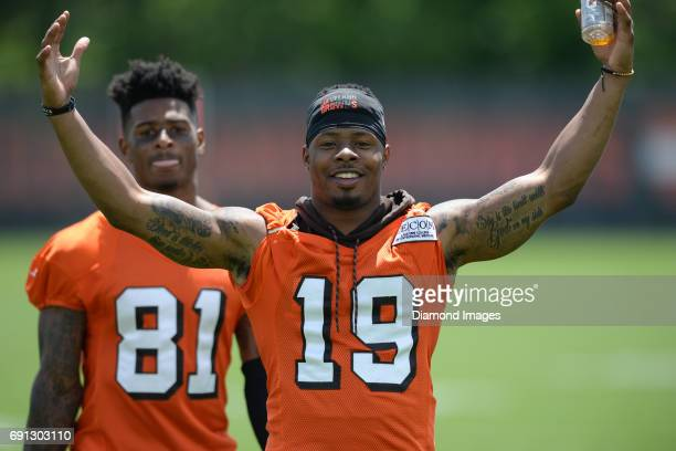 Wide receiver Corey Coleman of the Cleveland Browns poses for a picture as he walks off the field after an OTA practice on May 31 2017 at the...