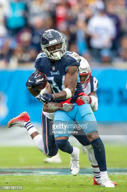 Wide receiver Corey Davis of the Tennessee Titans carries the ball during a NFL game against the New England Patriots at Nissan Stadium on November...