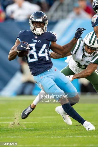Wide receiver Corey Davis of the Tennessee Titans carries the ball during a NFL game against the New York Jets at Nissan Stadium on December 2 2018...