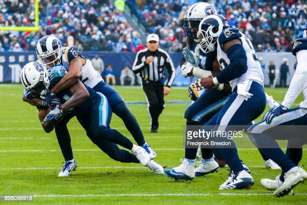 Wide Receiver Corey Davis of the Tennessee Titans carries the ball against Corner Back Trumaine Johnson of the Los Angeles Rams at Nissan Stadium on...