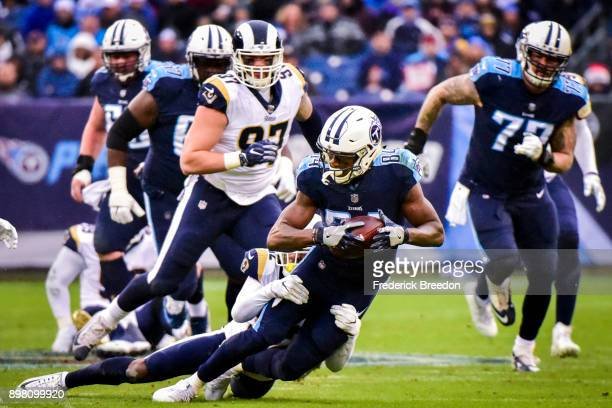 Wide Receiver Corey Davis of the Tennessee Titans carries the ball against the Los Angeles Rams at Nissan Stadium on December 24 2017 in Nashville...