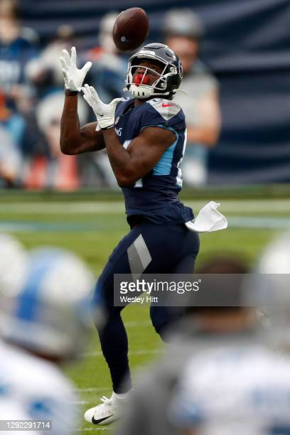 Wide receiver Corey Davis of the Tennessee Titans completes a reception for a touchdown over the Detroit Lions during the first quarter of the game...