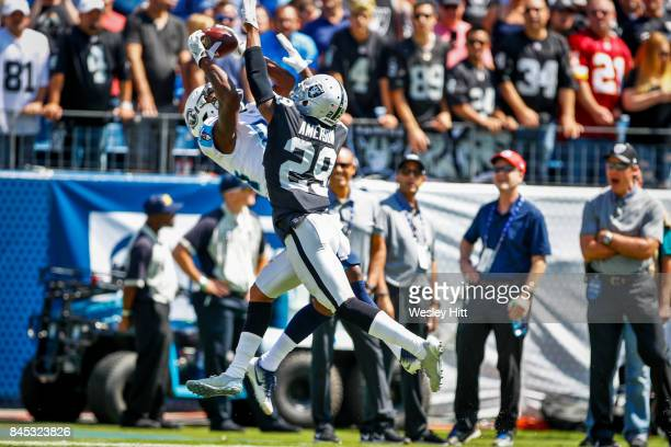 Wide receiver Corey Davis of the Tennessee Titans makes a catch against corner back David Amerson of the Oakland Raiders in the first half at Nissan...