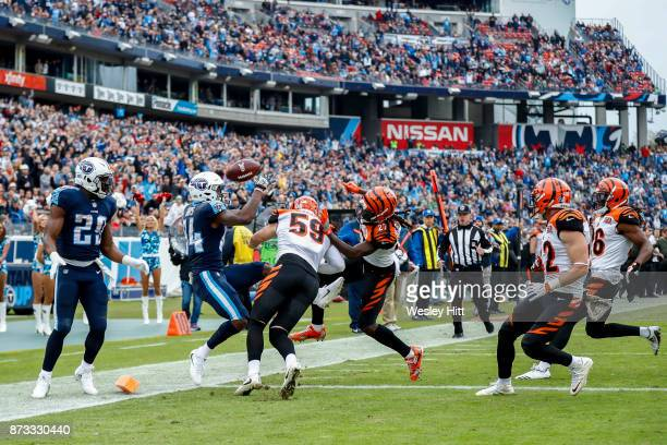 Wide Receiver Corey Davis of the Tennessee Titans tries to control the ball against Cornerback Dre Kirkpatrick of the Cincinnati Bengals at Nissan...