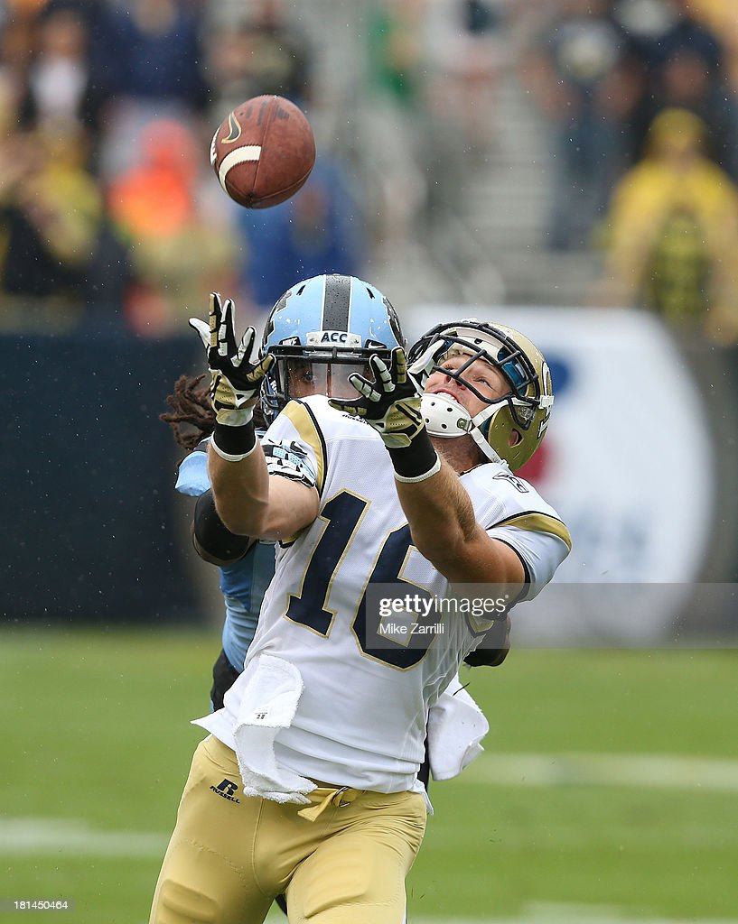 Wide receiver Corey Dennis #16 of the Georgia Tech Yellow Jackets reaches for a pass while safety Tre Boston #10 of the North Carolina Tar Heels defends him and puts his hand on Dennis's arm during the game against the at Bobby Dodd Stadium at Historic Grant Field on September 21, 2013 in Atlanta, Georgia.