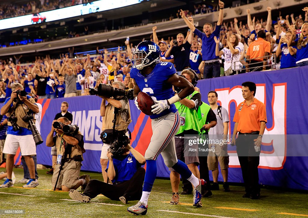 Wide receiver Corey Washington #6 of the New York Giants celebrates after scoring the game winning touchdown against the Pittsburgh Steelers in the fourth quarter during a preseason game at MetLife Stadium on August 9, 2014 in East Rutherford, New Jersey.