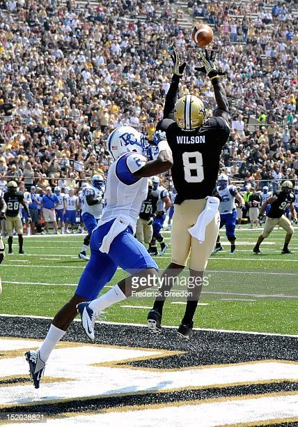 Wide receiver cornerback Trey Wilson of the Vanderbilt Commodores intercepts a pass and runs it back for a 100yard touchdown against the Presbyterian...