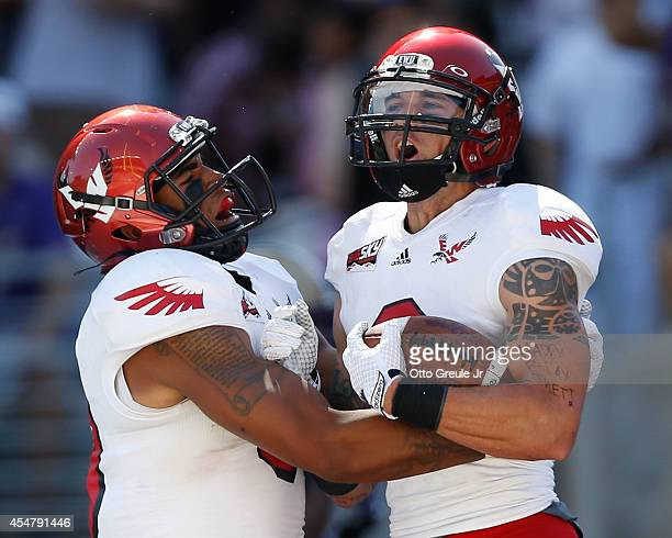 Wide receiver Cory Mitchell of the Eastern Washington Eagles celebrates with a teammate after scoring a touchdown in the first half against the...
