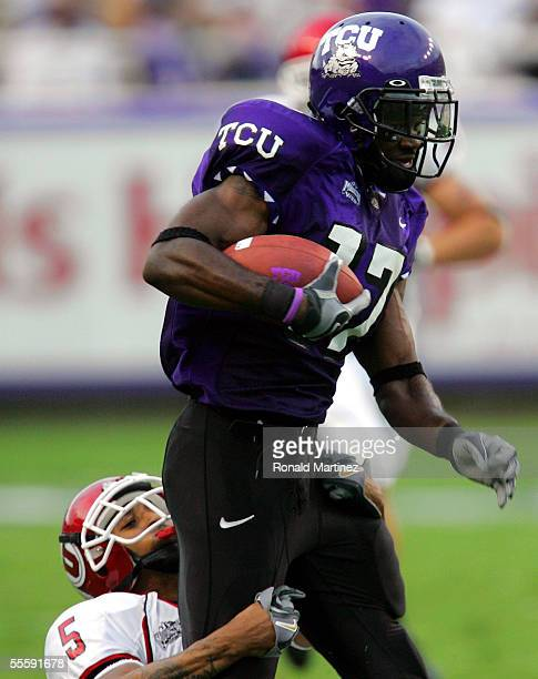 Wide receiver Cory Rodgers of the Texas Christian University Horned Frogs runs against defensive back Ryan Smith of the Utah Utes on September 15,...