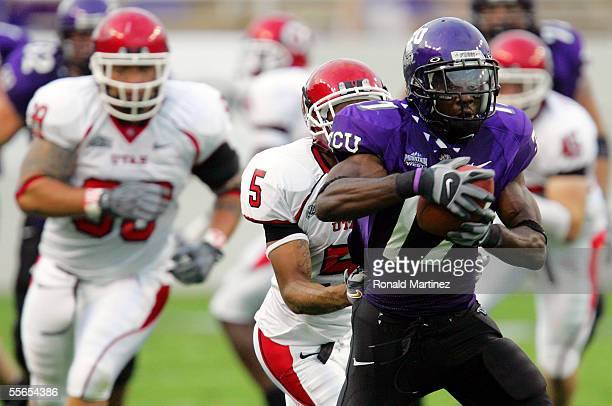 Wide receiver Cory Rodgers of the Texas Christian University Horned Frogs makes a pass reception against Ryan Smith of the Utah Utes on September 15,...