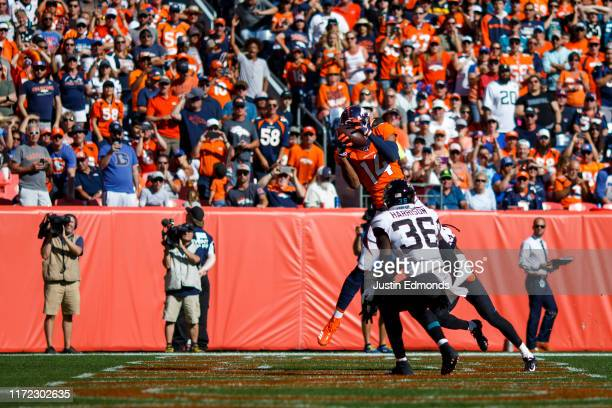 Wide receiver Courtland Sutton of the Denver Broncos catches a touchdown pass as defensive back Ronnie Harrison of the Jacksonville Jaguars defends...