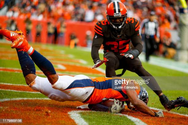 Wide receiver Courtland Sutton of the Denver Broncos catches a touchdown pass as safety Jermaine Whitehead of the Cleveland Browns defends on the...