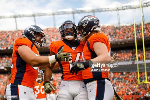 Wide receiver Courtland Sutton of the Denver Broncos celebrates his touchdown reception with fullback Andy Janovich and tight end Troy Fumagalli...