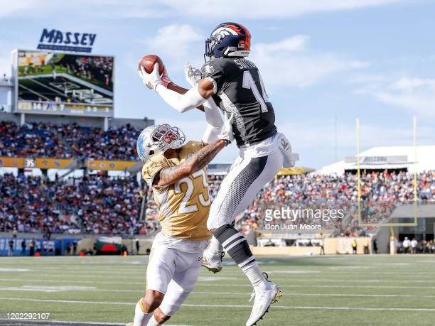 Wide Receiver Courtland Sutton of the Denver Broncos from the AFC Team goes up for a catch over Cornerback Darius Slay of the Detroit Lions from the...
