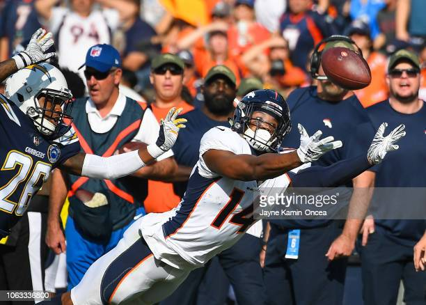 Wide receiver Courtland Sutton of the Denver Broncos makes a catch in front of cornerback Casey Hayward of the Los Angeles Chargers in the second...