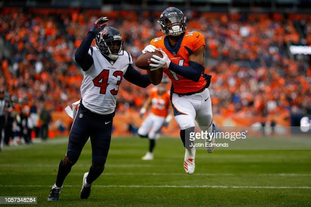 Wide receiver Courtland Sutton of the Denver Broncos nearly has a touchdown catch before dropping the ball under coverage by defensive back Shareece...