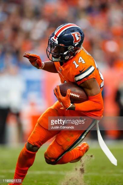 Wide receiver Courtland Sutton of the Denver Broncos runs with the football against the Detroit Lions during the third quarter at Empower Field at...