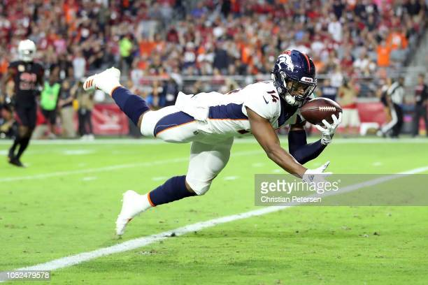 Wide receiver Courtland Sutton of the Denver Broncos scores a 28-yard touchdown during the first quarter against the Arizona Cardinals at State Farm...